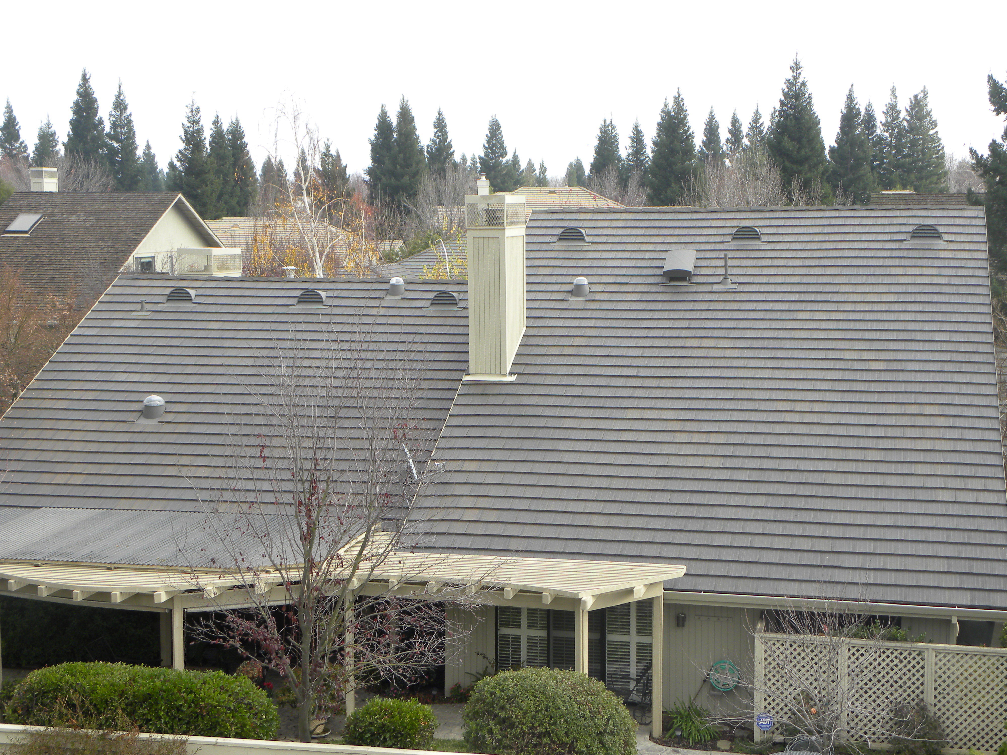 Large Half Round Dormer Vents Installed On The Back Of A Roof In Gold River,