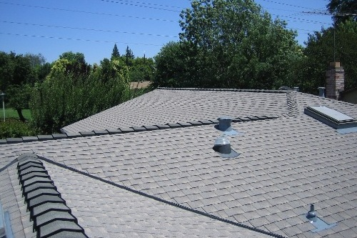 "Elk (now owned by GAF) was one of the first companies to come out with a dedicated ""Cool Shingle"" line. This is one of the earliest installations of that Cool Shingle line and now every composition shingle manufacturer has a ""cool color"" or ""Energy Star"" rated shingle, and with varying colors to choose from."
